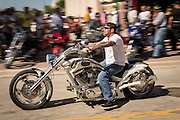 Leather clad bikers ride down Main Street during the 74th Annual Daytona Bike Week March 8, 2015 in Daytona Beach, Florida. More than 500,000 bikers and spectators gather for the week long event, the largest motorcycle rally in America.