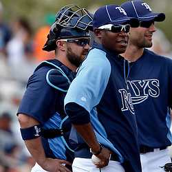 March 8, 2011; Port Charlotte, FL, USA; Tampa Bay Buccaneers head coach Raheem Morris serves as a guest coach for the Tampa Bay Rays during a spring training exhibition game against the Toronto Blue Jays at Charlotte Sports Park.   Mandatory Credit: Derick E. Hingle