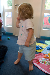 Toddler in Nursery School playroom,