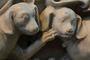 Dogs at the feet of the effigy of Marguerite d'Artois, d. 1311, wife of Louis de France, daughter of Philippe d'Artois, wearing a chin guard, made early 14th century for the Eglise des Jacobins in Paris and moved to Saint-Denis in 1817, in the Basilique Saint-Denis, Paris, France. The basilica is a large medieval 12th century Gothic abbey church and burial site of French kings from 10th - 18th centuries. Picture by Manuel Cohen