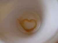A heart in the bottom of an empty coffe mug