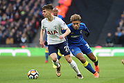 AFC Wimbledon striker Lyle Taylor (33) battles for possession with Juan Foyth of Tottenham Hotspur (21) during the The FA Cup 3rd round match between Tottenham Hotspur and AFC Wimbledon at Wembley Stadium, London, England on 7 January 2018. Photo by Matthew Redman.