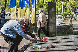April 26, 2018 - Kiev, Kiev, Ukraine - A couple lay flowers in the memorial of the dead Chernobyl workers during the celebrations in Kiev of the 32nd anniversary of the Chernobyl  nuclear accident, Ukraine. (Credit Image: © Celestino Arce/NurPhoto via ZUMA Press)