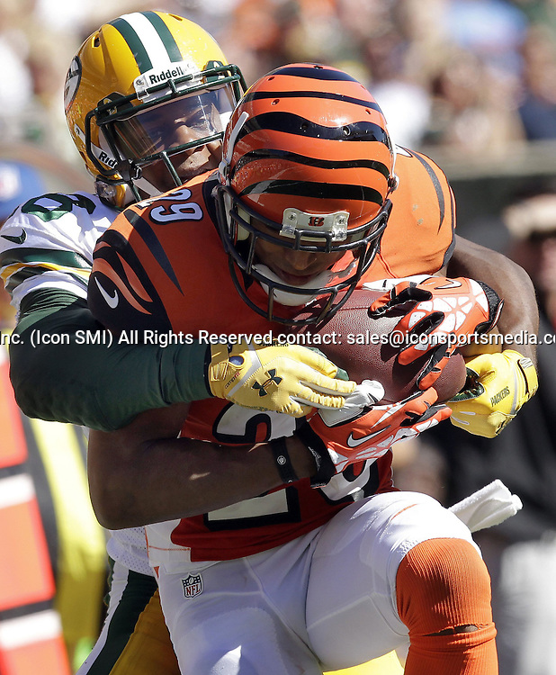Sept. 22, 2013 - Cincinnati, OH, USA - Cincinnati Bengals cornerback Leon Hall (29) is tackled by Green Bay Packers wide receiver Randall Cobb (18) after intercepting a pass during the fourth quarter on Sunday, September 22, 2013, at Paul Brown Stadium in Cincinnati, Ohio
