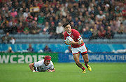 Leicester, Great Britain, Nathan HITAYAMA leaves, Mihai MACOVEI, grounded, during the Pool D game, Canada vs Romania.  2015 Rugby World Cup,  Venue, Leicester City Stadium, ENGLAND.  Tuesday,   06.10.2015.   [Mandatory Credit; Peter Spurrier/Intersport-images]