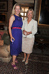 Left to right, JULIET FETHERSTONHAUGH and ANNE SINGER at a lunch in aid of the charity Kids Company held at Mark's Club, 46 Charles Street, London on 3rd October 2011.