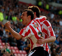 Photo: Jed Wee/Sportsbeat Images.<br /> Sunderland v Wolverhampton Wanderers. Coca Cola Championship. 07/04/2007.<br /> <br /> Sunderland's Ross Wallace (L) joins in the celebrations after their first goal.