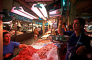 A stallholder of fresh fish and seafood weighs prawns on her scales in the covered Mercat l'Olivar market, on 21st June 2001, in Palma, Mallorca, Balearic Islands, Spain. (Photo by Richard Baker / In Pictures via Getty Images)