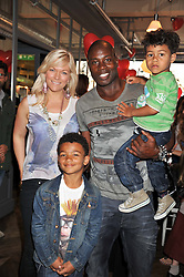MARTIN OFFIAH and VIRGINIA SHAW with their sons TYLER and PHOENIX at a tea party to celebrate the launch of the limited edition Heart & Sole shoe collection by Step2wo in aid of the British Heart Foundation's Mending Broken Hearts Appeal, held at Aubaine on 2, Selfridge's, Oxford Street, London on 4th July 2012.
