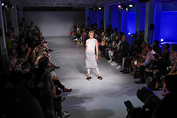 © Licensed to London News Pictures. 13/09/2019. LONDON, UK.  A model presents a look by Wear Polish: Acephala during Fashion Scout SS20, an off schedule show at Victoria House in Bloomsbury Square, on the opening day of London Fashion Week.  Photo credit: Stephen Chung/LNP