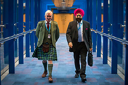 © Licensed to London News Pictures. 03/10/2018. Birmingham, UK. Two conservative delegates make their way to the main hall for the Prime Minister Theresa May's speech on the final day of the Conservative Party Conference being held at the International Convention Centre in Birmingham. Photo credit: Andrew McCaren/LNP