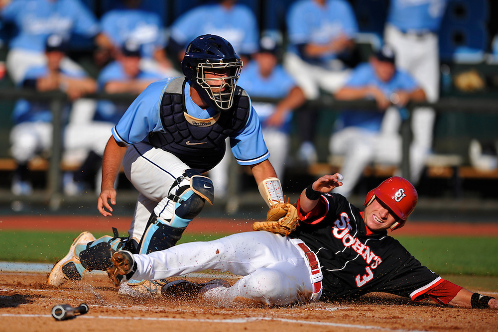 North Carolina catcher Jacob Stallings (5) tags out St. John's baserunner Sean O'Hare (3) at home plate in the second inning during the 2012 NCAA Regionals at Boshamer Stadium in Chapel Hill, NC.