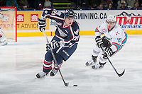 KELOWNA, CANADA - JANUARY 22: Dillon Dube #19 of Kelowna Rockets back checks Vladislav Lukin #21 of Tri City Americans as he skates with the puck during first period on January 22, 2016 at Prospera Place in Kelowna, British Columbia, Canada.  (Photo by Marissa Baecker/Shoot the Breeze)  *** Local Caption *** Dillon Dube; Vladislav Lukin;
