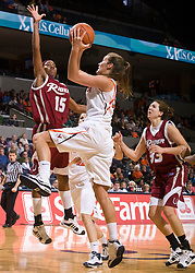 Virginia forward Chelsea Shine (50) shoots over Rider forward Shaunice Parker (15).  The #15 ranked Virginia Cavaliers defeated the Rider Broncs 83-38 in the Marriott Cavalier Classic Basketball Tournament at the John Paul Jones Arena on the Grounds of the University of Virginia in Charlottesville, VA on December 28, 2008.