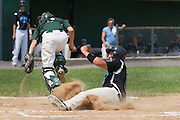 Pennsylvania's Trent Grove steals home on a double steal as West Deptford's Jason Roselli grabs a wild throw to home during a elimination bracket game of the Eastern Regional Senior League tournament held in West Deptford on Monday, August 8.