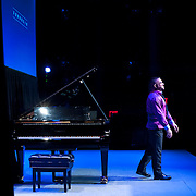 """March 9, 2013 - New York, NY : Pianist Anthony De Mare, takes a bow after performing  """"Liaisons II: Re-Imagining Sondheim From the Piano,"""" a series of Stephen Sondheim-inspired piano works at Symphony Space in Manhattan on Saturday night. CREDIT: Karsten Moran for The New York Times"""