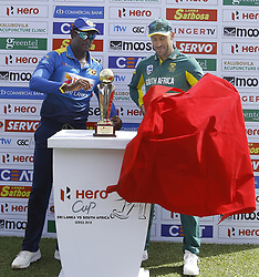 July 29, 2018 - Dambulla, Sri Lanka - Sri Lankan captain Angelo Mathews (L)  and South African captain Faf Du Plessis unveil the trophy during the 1st One Day International cricket match between Sri Lanka and South Africa at Rangiri Dambulla International Stadium, Dambulla, Sri Lanka on Sunday 29 July 2018  (Credit Image: © Tharaka Basnayaka/NurPhoto via ZUMA Press)