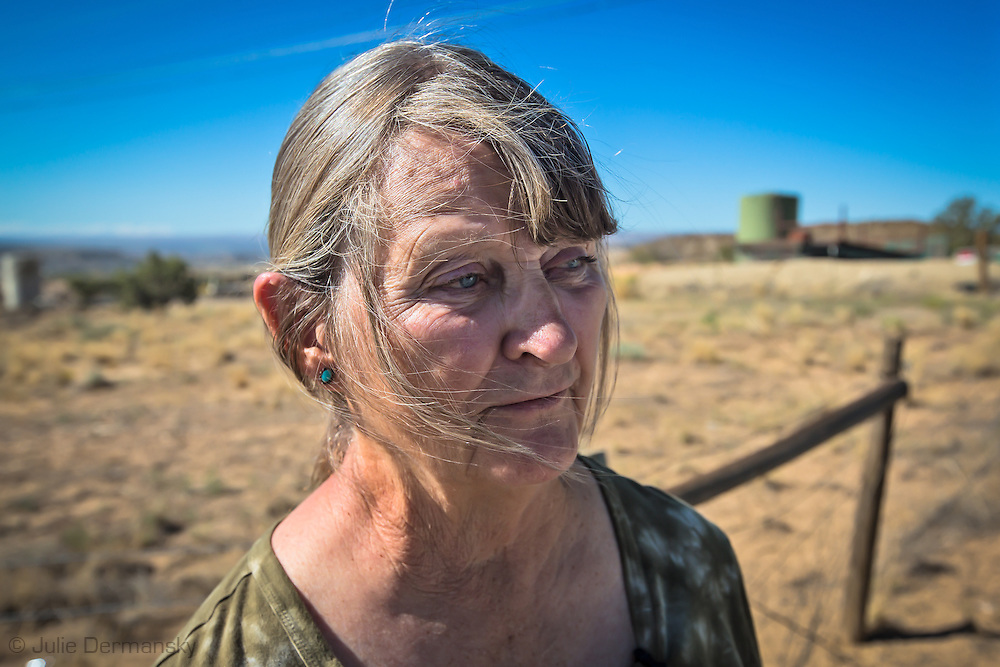 Anti-fracking activisty, Shirley McNall, who goes by Sugar, in front of a fracking industry site in the San Juan Basin. Sugar  leads a tour of toxic sites in the San Juan basin in the hopes of educating people to the dangers of the fracking industry.