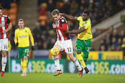 Sheffield United's James Wilson and Norwich City's Alexander Tettey during the EFL Sky Bet Championship match between Norwich City and Sheffield Utd at Carrow Road, Norwich, England on 20 January 2018. Photo by John Marsh.