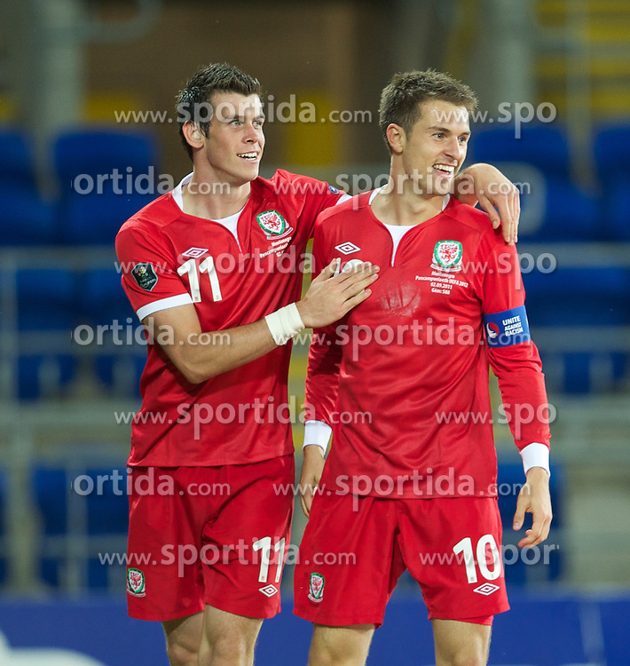 02.09.2011, Cardiff City Stadium, Cardiff, WAL, UEFA Euro 2012, Qualifier, Wales vs Montenegro, im Bild Wales' captain Aaron Ramsey celebrates scoring the second goal against Montenegro with Gareth Bale during the UEFA Euro 2012 Qualifying Group G match at the  Cardiff City Stadium, EXPA Pictures © 2011, PhotoCredit: EXPA/ Propaganda/ D. Rawcliffe *** ATTENTION *** UK OUT!