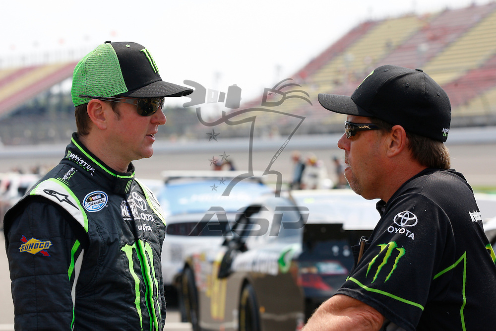 BROOKLYN, MI - JUN 16, 2012:  Kyle Busch (54) and crew chief, Mike Beam, discuss strategy before the running of the Alliance Truck Parts 250 at the Michigan International Speedway in Brooklyn, MI.
