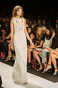 A white dress with lace accents at the BCBGMAXAZRIA show at the Spring 2013 Mercedes Benz Fashion Week show in New York.