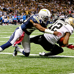 October 7, 2012; New Orleans, LA, USA; New Orleans Saints wide receiver Marques Colston (12) catches a touchdown as San Diego Chargers cornerback Antoine Cason (20) defends during the fourth quarter of a game at the Mercedes-Benz Superdome. Mandatory Credit: Derick E. Hingle-US PRESSWIRE