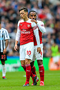 Alexandre Lacazette (#9) of Arsenal consoles /a10 after he is pulled up for a foul during the Premier League match between Newcastle United and Arsenal at St. James's Park, Newcastle, England on 15 September 2018.