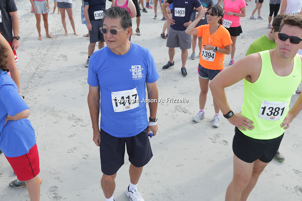 The 2nd Annual Wrightsville Beach Foundation Pier to Pier to Pier Run/Walk, Crab Crawl and SUP Race was held Saturday June 7, 2014. (Jason A. Frizzelle)