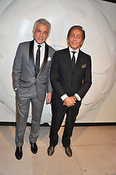 Left to right, GIANCARLO GIAMMETTI and fashion designer VALENTINO at a private view of 'Valentino: Master Of Couture' at Somerset House, London on 28th November 2012.