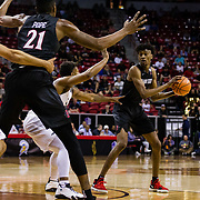 09 March 2018: San Diego State men's basketball takes on Nevada in the quarterfinal round of the Mountain West Conference Tournament. San Diego State Aztecs forward Jalen McDaniels (5) looks to pass while being defended by a Nevada player in the first half. The Aztecs cruise past the Wolfpack 90-73 to move on to the Championship game tomorrow afternoon at 3pm.<br /> More game action at www.sdsuaztecphotos.com