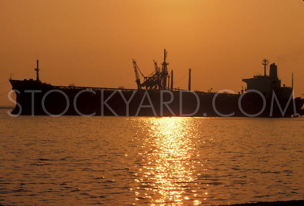 Silhouette of a tanker on the water at sunset