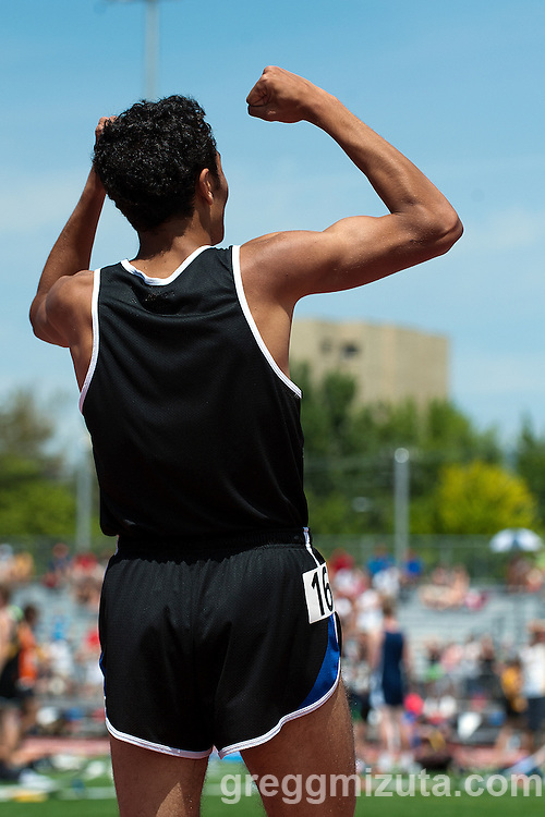Timberline senior Andrew Rafla raises his arms after the scoreboard flashed his time at the finish of the Idaho State Track & Field Championship 5A 1600 meter run at Dona Larsen Park, Boise, Idaho on May 16, 2014. Rafia's winning time (4:10.33) set a new 5A classification record.