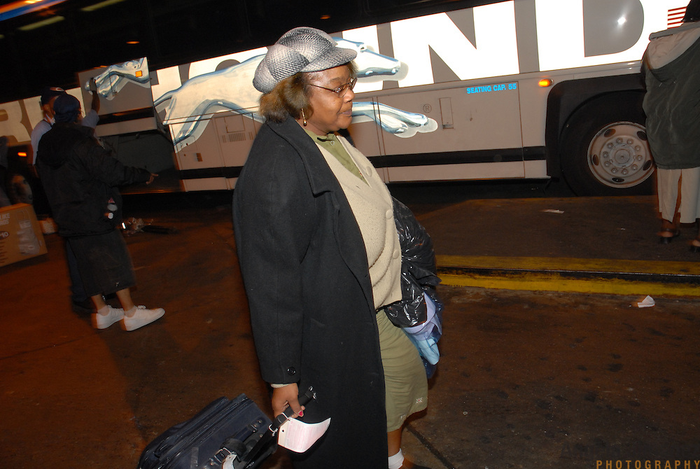 DATE: 11/30/06<br /> DESK: METRO<br /> SLUG: DORISMOND<br /> ASSIGN ID: 30034202A<br /> <br /> Marie Rose Dorismond, whose son, Patrick, 26, was killed by undercover New York City Police narcotics detective Anthony Vasquez during a drug buy-and-bust operation on March 16, 2000 arrives at the Port Authority bus terminal in New York City after a 27-hour Greyhound bus ride from her home in Port St. Lucie, Florida on November 30, 2006. She has come back to the city to attend the funeral of Sean Bell, 23, who was killed last week by New York City police officers. Vasquez was acquitted of all charges related to the killing of Dorismond's son. <br /> <br /> photo by Angela Jimenez for The New York Times<br /> photographer contact 917-586-0916