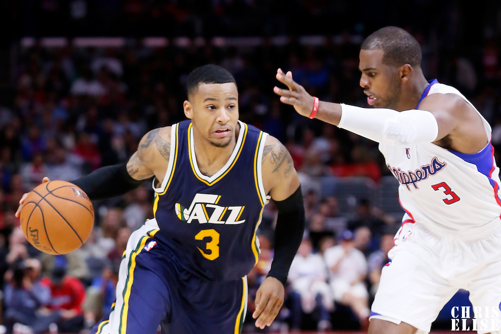 17 October 2014: Utah Jazz guard Trey Burke (3) drives past Los Angeles Clippers guard Chris Paul (3) during the Los Angeles Clippers 101-97 victory over the Utah Jazz, in a preseason game, at the Staples Center, Los Angeles, California, USA.