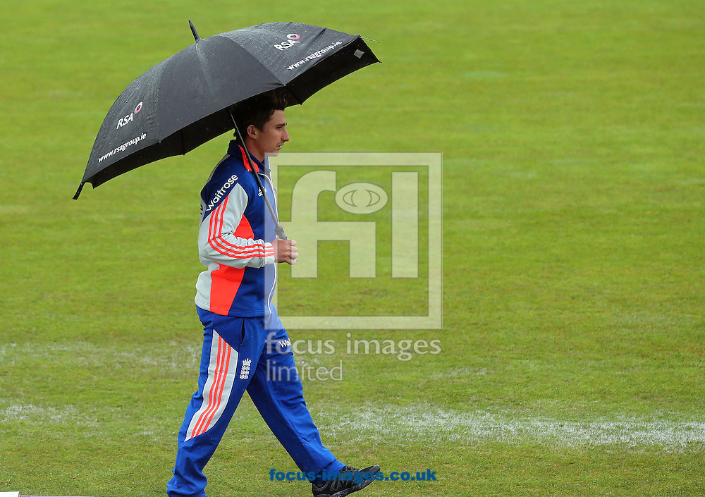 England captain James Taylor makes his way across the pitch after the the One Day International match at the Village, Malahide was abandoned due to bad weather<br /> Picture by Lorraine O'Sullivan/Focus Images Ltd +353 872341584<br /> 08/05/2015