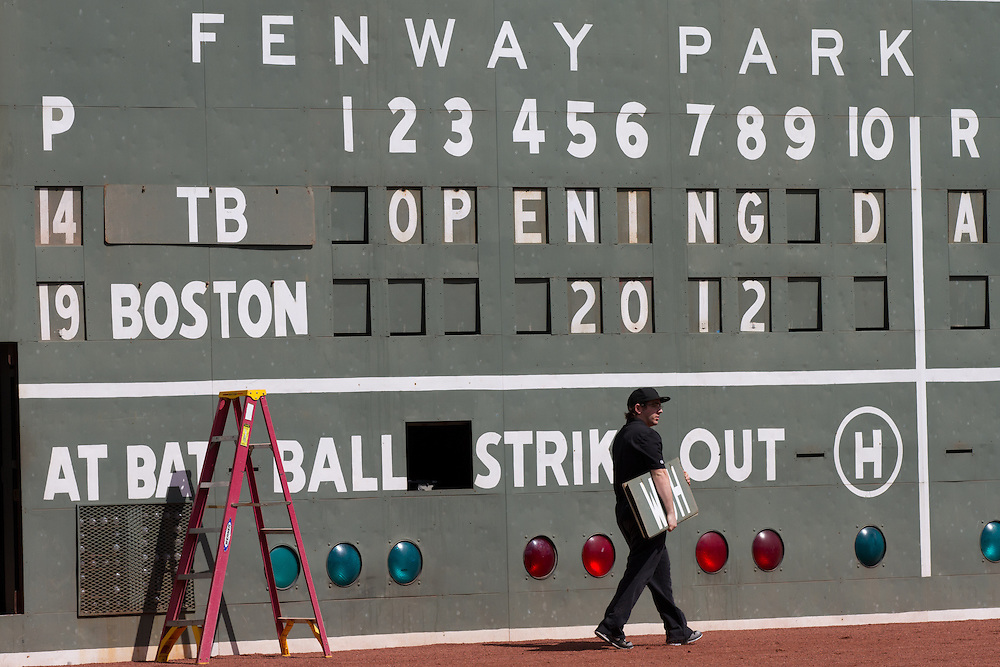 A worker prepares the left field scoreboard prior to the Boston Red Sox' game against the Tampa Bay Rays at Fenway Park in Boston, Massachusetts, USA on 13 April 2012. The game marks the season home opener for the Red Sox who have won just one game so far this year.
