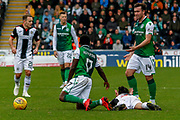 Ryan Edwards of St Mirren fouled again by Thomas Agyepong of Hibernian FC during the Ladbrokes Scottish Premiership match between St Mirren and Hibernian at the Simple Digital Arena, Paisley, Scotland on 29th September 2018.