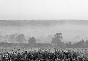 View of crowd and stages with large field and sky backdrop. Glastonbury 2000
