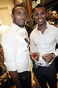 l to r: Model Gee Polanco and Edward D'Angelo  at The Sean John Boutique on Fifth Ave on September 10, 2009  in New York City