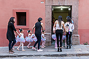 Young Mexican girls dressed in tutus are escorted by their mothers on their way to ballet class March 23, 2018 in San Miguel de Allende, Mexico.