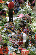 Women prepare their goods for market in Chichicastenango, Guatemala.