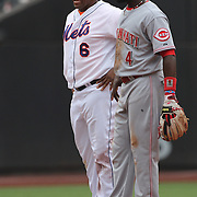 Brandon Phillips, Cincinnati Reds, shares a joke at second base with Marlon Byrd, New York Mets, during the New York Mets V Cincinnati Reds Baseball game at Citi Field, Queens, New York. 22nd May 2012. Photo Tim Clayton