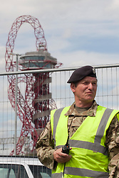 © licensed to London News Pictures. London, UK 12/07/2012. A soldier patrolling outside the Olympic site vehicle entrance in Stratford, today (12/07/12). Photo credit: Tolga Akmen/LNP