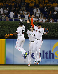 June 21, 2017 - Miami, Florida, U.S. - Miami Marlins players MARCELL OZUNA, CHRISTIAN YELICH and GIANCARLO STANTON celebrate after a 2-1 win over the Washington Nationals on Wednesday, at Marlins Park. (Credit Image: © David Santiago/TNS via ZUMA Wire)