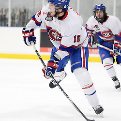 TORONTO, ON - Mar 31 : Ontario Junior Hockey League, Toronto Patriots v Toronto Jr. Canadiens, SouthWest Championship Series, Game 3. Andrew Mullen #10 of the Toronto Jr. Canadiens passes the puck during the third period.<br /> (photo by Jay Johnston / OJHL Images)