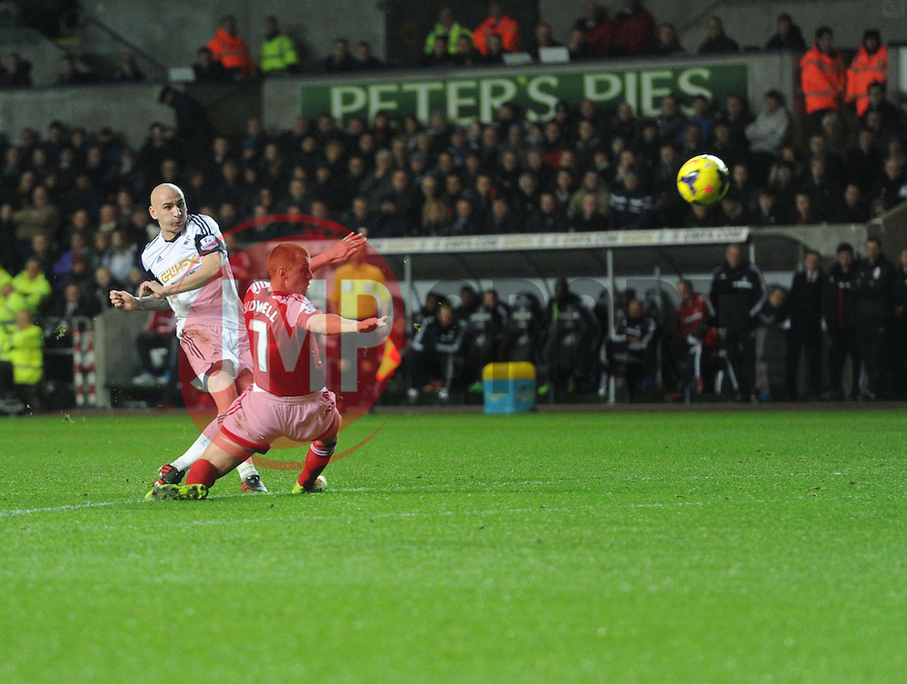Swansea City's Jonjo Shelvey hits the cross bar. - Photo mandatory by-line: Alex James/JMP - Tel: Mobile: 07966 386802 28/01/2014 - SPORT - FOOTBALL - Liberty Stadium - Swansea - Swansea City v Fulham - Barclays Premier League