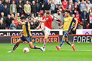 Barnsley FC midfielder Marley Watkins (15) takes a shot at goal deflected by Bristol City defender Scott Golbourne (13) during the EFL Sky Bet Championship match between Barnsley and Bristol City at Oakwell, Barnsley, England on 29 October 2016. Photo by Ian Lyall.