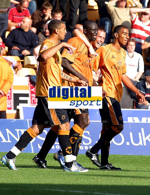 Photo: Dave Linney.<br />Wolverhampton Wanderers v Stoke City. Coca Cola Championship. 23/09/2006Wolves's.Seyi  Olofinjana(Second from left) celebrates after putting Wolves further ahead.