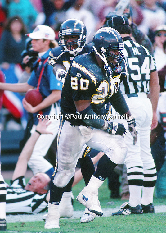 San Diego Chargers running back Natrone Means (20) yells out in celebration and high steps after scoring a touchdown during the NFL AFC Divisional playoff football game against the Miami Dolphins on Jan. 8, 1995, in San Diego. The Chargers won the game 22-21. (©Paul Anthony Spinelli)